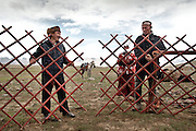 The Khan (left) and Daryo Boi..Setting up the yurt of the Khan, the tribal leader, during yearly summer migration. Afghan Kyrgyz are semi-nomadic people...Trekking through the high altitude plateau of the Little Pamir mountains (average 4200 meters) , where the Afghan Kyrgyz community live all year, on the borders of China, Tajikistan and Pakistan.