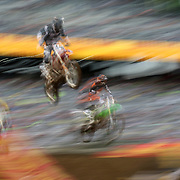 A blur of motion as a competitors fly through the air during the Monster Energy AMA Supercross series held at MetLife Stadium. 62,217 fans attended the event held for the first time at MetLife Stadium, New Jersey, USA. 26th April 2014. Photo Tim Clayton