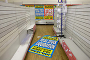 On the last day of trading, surrounded by empty shelves and shop fittings, sheets of closing down posters are seen lying on the shop floor in the Camberwell branch of Woolworths department store in London. In its 100th year, the iconic high street chain of affordable goods has welcomed generations of shoppers since its first outlet opened in 1909 In a period of financial turmoil when recession followed the credit crunch, Woolworths went into administration in November 2008 with debts of £385m Pounds. Its 815 nationwide outlets were forced to close and its 27,000 workers laid off.