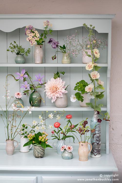 Dresser at Green and Gorgeous with some of Rachel's favourite flowers. Left to right, top row: Eryngium planum 'White Glitter', Phlox drummondii 'Crème Brûlée', Lathyrus odoratus 'Nimbus', Gypsophila elegans 'Rosea' - Baby's breath. Middle row: Zinnia elegans 'Zinderella Lilac', Clematis Star River syn.'Zostarri', Dahlia 'Café au Lait', Malope trifida 'Alba'. Bottom row: Gaura lindheimeri 'Summer Breeze', Clematis 'Paul Farges' - Summer Snow, Hypericum Magical Beauty syn. 'Kolmbeau', Helichrysum bracteatum Salmon, Zinnia elegans 'Zinderella Lilac', Nicotiana 'Hot Chocolate' and × Alcalthaea suffrutescens 'Parkallee' - Hollyhock.