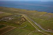 Nederland, Groningen, Gemeente De Marne, 08-09-2009; dijk  van de Noordpolder met op- en afritten, ten Noorden van Warffum. De waterpartij is aangelegde natuur. Buitendijks, in het wad, landaanwinning. Aaan de horizon Schiermonnikoog en Rottumerplaat (r)..Dike of the Noordpolder with ramps, north of Warffum. Outside de dike, in the wad, land reclamation.luchtfoto (toeslag); aerial photo (additional fee required); .foto Siebe Swart / photo Siebe Swart