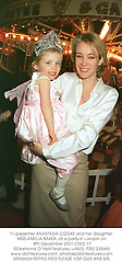 TV presenter ANASTASIA COOKE and her daughter MISS AMELIA BAKER, at a party in London on 8th December 2001.OWD 17