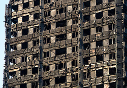 © Licensed to London News Pictures. 16/06/2017. London, UK. Evening sunshine bathes the burnt remains of Grenfell Tower. The blaze engulfed the 27-storey building in the early hours of June 13th. Police say 30 people have been killed with 34 still in hospital, 18 of whom are in critical condition. The fire brigade say that they don't expect to find anyone else alive. Photo credit: Peter Macdiarmid/LNP