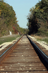 20 October 2007:  Railroad tracks are lined by the colors of fall foliage.