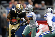 New Orleans Saints wide receiver Marques Colston (12) carries the ball down the field against the Dallas Cowboys at Cowboys Stadium in Arlington, Texas, on December 23, 2012.  (Stan Olszewski/The Dallas Morning News)