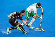 Ireland's Chris Cargo is tackled by Tanguy Cosyns of Belgium. Ireland v Belgium - Unibet EuroHockey Championships, Lee Valley Hockey & Tennis Centre, London, UK on 25 August 2015. Photo: Simon Parker