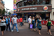 Visitors walk past Burger King in Leicester Sq. This Square is a mecca for tourists, hence the many fast food restaurants that surround the area.