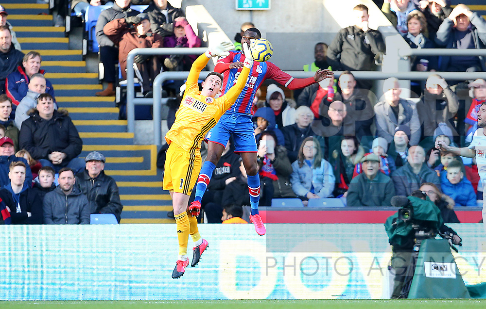 Sheffield United's goalkeeper Dean Henderson gets to the ball ahead of Crystal Palace's Christian Benteke during the Premier League match at Selhurst Park, London. Picture date: 1st February 2020. Picture credit should read: Paul Terry/Sportimage