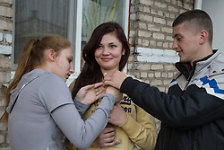 Elena, 17, (c) and Diana, 17, (l) with kitten. Elena has been a resident of Lugansk Orphanage No.1 since the age of three, the kitten is a present from her boyfriend Sergey, 22, (r).