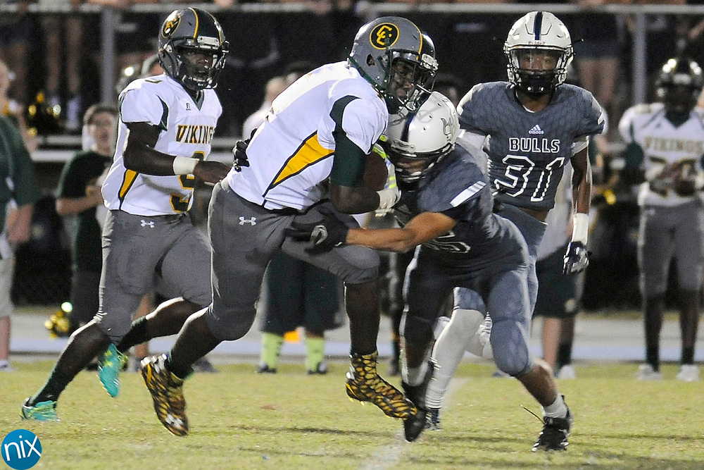 Vikings running back Demarcus Alexander (4) is hit by a Ragin' Bulls defender during the Central Cabarrus Vikings at Hickory Ridge Ragin' Bulls high school football game on Friday  night.