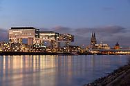 view over the Rhine to the Kranhaeuser (Crane Houses) in the Rheinau harbour and the cathedral, Cologne, Germany.<br /> <br /> Blick ueber den Rhein zu den Kranhaeusern im Rheinauhafen und zum Dom, Koeln, Deutschland.