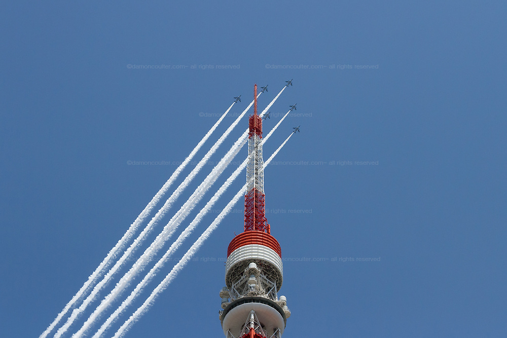 """The JASDF Blue Impulse aerobatics team do a fly past over Tokyo Tower in Tokyo. Friday May 29th 2020 . From 12:40 to 1pm the Kawasaki T4 aircraft of the Japanese Air Self Defence Force aerobatics display team circled the major sites of the city along with hospitals caring for Corona patients, trailing white smoke, as a """"thank you"""" to healthcare workers for their efforts during the  COVID-19 State of Emergency that was ended on Monday, May 25th The JASDF Blue Impulse aerobatics team do a fly past over Tokyo Tower in Tokyo. Friday May 29th 2020 . From 12:40 to 1pm the Kawasaki T4 aircraft of the Japanese Air Self Defence Force aerobatics display team circled the major sites of the city along with hospitals caring for Corona patients, trailing white smoke, as a """"thank you"""" to healthcare workers for their efforts during the  COVID-19 State of Emergency that was ended on Monday, May 25th"""