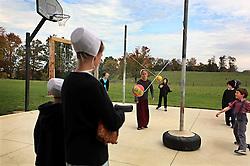 Amish children play at their school playground in Berlin, Ohio, Oct. 12, 2009.