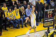 Golden State Warriors guard Klay Thompson (11) watches a three point shot go in the basket against the Cleveland Cavaliers during Game 1 of the NBA Finals at Oracle Arena in Oakland, Calif., on May 31, 2018. (Stan Olszewski/Special to S.F. Examiner)