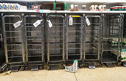 © Licensed to London News Pictures. 07/10/2021. London, UK. Empty shelves of fresh milk in Sainsbury's, north London just after 9am. The Government and retailers warn that food shortages could continue until Christmas due to labour shortages following Brexit. Photo credit: Dinendra Haria/LNP