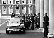 EEC Leaders Meet At Dublin Castle.   (N4)..1979..29.11.1979..11.29.1979..29th November 1979..At Dublin Castle the leaders of the countries within the EEC held a summit conference to discuss issues which would affect the EEC over the forthcoming years..Image shows the Irish Minister for Foreign Affairs, Mr Michael O'Kennedy, retrieving his case from the car on his arrival at Dublin Castle for the EEC summit.