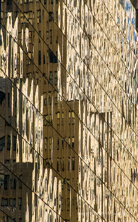 Reflections in windows of 300 Madison Building, mid-town Manhattan, New York City, New York