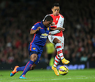 Arsenal's Alexis Sanchez tussles with Manchester United's Antonio Valencia<br /> <br /> Barclays Premier League- Arsenal vs Manchester United - Emirates Stadium - England - 22nd November 2014 - Picture David Klein/Sportimage