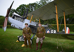 © Licensed to London News Pictures. 29/08/2012. Old Warden, UK Two men in reproduction WW1 uniforms stand with the Royal Aircraft Factory RE.8, a reproduction. The Royal Airforce Museum unveils three World War One aircraft at the Shuttleworth Aerodrome in Bedfordshire today, 29th August 2012.  The Snipe, Albatros DVa and RE8 will fly in airshows before going on public display at the Museum's London site Photo credit : Stephen Simpson/LNP