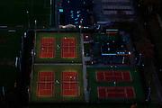 Nederland, Utrecht, Maartensdijk, 15-11-2010; Sportvelden bij Maartensdijk met gravel of hardcourt tennisbanen bij kunstlicht..Playing fields with tennis courts in the twilight..luchtfoto (toeslag), aerial photo (additional fee required).foto/photo Siebe Swart