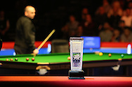 the new Ray Reardon trophy is seen during the match as Stuart Bingham eyes up a pot.  Coral Welsh Open Snooker 2017, final match, Judd Trump of England v Stuart Bingham of England at the Motorpoint Arena in Cardiff, South Wales on Sunday 19th February 2017.<br /> pic by Andrew Orchard, Andrew Orchard sports photography.