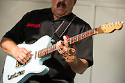 Pat Curtis performs a guitar solo as Fast Lane Band performs during the Milpitas Summer Concert Series at Murphy Park in Milpitas, California, on July 14, 2015. (Stan Olszewski/SOSKIphoto)