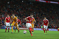 Gareth Bale of Wales  shoots and scores his teams 4th goal from the penalty spot. Wales v Moldova , FIFA World Cup qualifier at the Cardiff city Stadium in Cardiff on Monday 5th Sept 2016. pic by Andrew Orchard,