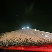 """Night view of Chandragup (meaning """"Moon Well""""), a sacred site to Hindu of 3 mud volcanoes (mainland Asia's largest ones)."""