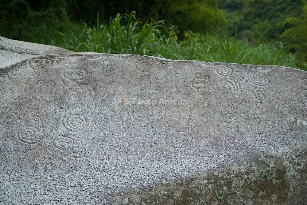 2009-04-29-Jayuya, Puerto Rico-  Written Stone, in Jayuya Puerto Rico.  The simbols n the stone were made by the Taino indians that lived in the island of Puerto Rico by the time the New World was discovered.  Petroglifos hechos por los indios tainos que vivian en Puerto Rico cuando esta fue descubierta por Cristobal Colon.