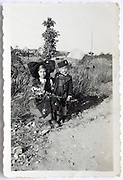 girl and boy dressed up posing with flowers France