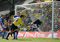 Photo: Lee Earle.<br /> Watford v Ipswich Town. Coca Cola Championship. 17/04/2006. Watford's Darius Henderson (L) heads past Ipswich keeper Lewis Price to score the opening goal.