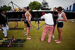 © London News Pictures. 03/07/2013. Henley-on-Thames, UK. A steward inspects a rowing boat on Day one of Henley Royal Regatta on the River Thames at Henley-on-Thames, Oxfordshire on July 03, 2013. Photo credit: Ben Cawthra/LNP