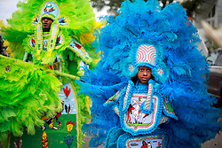 29 August 2014. Lower 9th Ward, New Orleans, Louisiana. <br /> Survivors of the storm. Mardi Gras Indian Michael 'Spy Boy' Tenner (10 yrs) of the Comanche Hunters and Herbert Motton of the Hot Head Hunters lead a touching second line parade along Tennessee Street in the Lower 9th Ward in memory of those who perished in the storm 9 years ago. <br /> Photo; Charlie Varley/varleypix.com