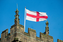 Cross of Saint George Flag flying from the Tower of Saint Marys Church Ecclesfield. It is believed that King Richard I of England (Richard the Lionheart) adopted St. George's Cross as his flag during his crusades.<br /> <br />  30 December 2018<br />  Copyright Paul David Drabble<br />  www.pauldaviddrabble.co.uk