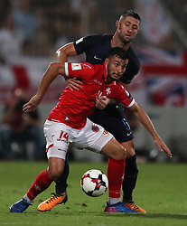 England's Gary Cahill and Malta's Jean Farrugia battle for the ball during the 2018 FIFA World Cup Qualifying, Group F match at the National Stadium, Ta' Qali. PRESS ASSOCIATION Photo. Picture date: Friday September 1, 2017. See PA story SOCCER Malta. Photo credit should read: Nick Potts/PA Wire. RESTRICTIONS: Use subject to FA restrictions. Editorial use only. Commercial use only with prior written consent of the FA. No editing except cropping.