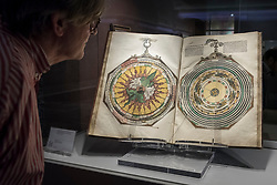 """© Licensed to London News Pictures. 28/06/2018. LONDON, UK. A visitor views """"Astronomicum Caesareum"""", 1540, by Petrus Apianus.  Members of the public visit Masterpiece London, the world's leading cross-collecting art fair held in the grounds of the Royal Hospital Chelsea.  The fair brings together 160 international exhibitors presenting works from antiquity to the present day and runs 28 June to 4 July 2018.  Photo credit: Stephen Chung/LNP"""