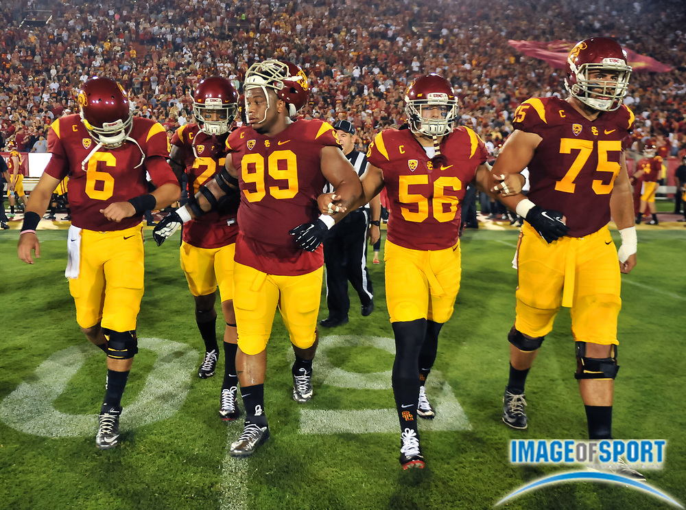 Sep 5, 2015; Los Angeles, CA, USA; Southern California Trojans team captains Kody Kessler (6), Su'a Cravens (21), Antwaun Woods (99), Anthony Sarao, and Max Turek (75) head to midfield for the coin toss before game against the Arkansas State Red Wolves at Los Angeles Memorial Coliseum. Photo by Ed Ruvalcaba