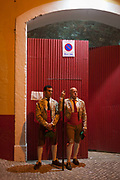 Two Portugese Forcados stand outside the bullring before the evenings bullfight Corrida de Touros, on 15th July 2016, at Caldas da Rainha, Portugal. A forcado is a member of a group of men that performs the pega de cara or pega de caras face catch, the final event in a typical Portuguese bullfight. They were initially professionals from lower classes but nowadays people from all social backgrounds practice their art through amateur groups. In the Portuguese version, unlike Spanish bullfights, the bull is not killed.