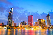 Colorful night view of Downtown center of Ho Chi Minh city on Saigon riverbank in twilight, Vietnam.