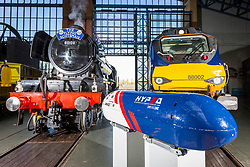© Licensed to London News Pictures. 26/04/2018. York UK. Picture shows the Flying Scotsman, a Electro-Diesel Class 88 & the UK's first Hyperloop Pod representing the past, present & future of Rail travel at York rail museum this morning. The revolutionary Hyperloop technology could see passenger pods travelling inside near-vacuum tubes at speeds of up to 650 mph and could theoretically reduce York to London journey times to just 20 minutes. The Hyperloop pod is at the museum to launch the museum's new visual identity & to mark the occasion bought together the past, present & future of rail travel. Photo credit: Andrew McCaren/LNP