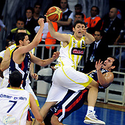 Fenerbahce Ulker's Mirsad TURKCAN (C) and Efes Pilsen's Kaya PEKER (R), Bostjan NACHBAR (L) during their Turkish Basketball league Play Off Final third leg match Fenerbahce Ulker between Efes Pilsen at the Abdi Ipekci Arena in Istanbul Turkey on Tuesday 25 May 2010. Photo by TURKPIX