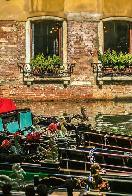 Gondolas in Venice, Italy. A sumptuary law of Venice required that gondolas should be painted black, and they are customarily so painted now.