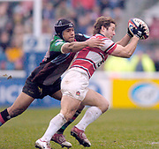 2004/05 Zurich Premiership,NEC Harlequins vs Gloucester, The Stoop,Twickenham, ENGLAND: Quins's Steve So'oailo, tackles Gloucester's Andy Gomersall.<br /> <br /> Twickenham. Surrey, UK., 5th February 2005, Zurich Premiership Rugby,  The Stoop,  [Mandatory Credit: Peter Spurrier/Intersport Images],