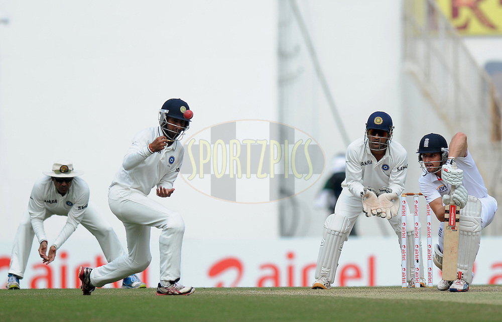 Cheteshwar Pujara of India fields as Nick Compton of England and MS Dhoni captain of India look on during day four of the 4th Airtel Test Match between India and England held at VCA ground in Nagpur on the 16th December 2012..Photo by  Pal Pillai/BCCI/SPORTZPICS .