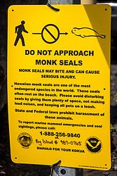 NOAA public sign for critically endangered Hawaiian monk seal, Monachus schauinslandi, Honokohau Harbor, Kona Coast, Big Island, Hawaii, USA, Pacific Ocean