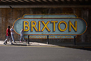 People walk past a Brixton wall mural under a Network Rail bridge on Ferndale Road on the 23rd May 2019 in London in the United Kingdom.