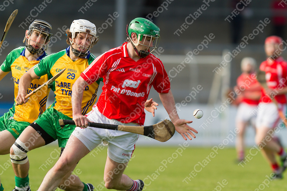 Crusheen's Fergus Kennedy grabs the slíotar watched by Inagh/Kilnamona's Kevin Hehir and Michael Vaughan