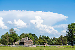 A thunderhead passes over an old barn in Rexburg Idaho.