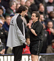 Ruud Van Nistelrooy (Utd) is booked by Referee Mr. Alan Wiley for entering the field to dispute the penalty appeal. Fulham v Manchester United. 28/2/04. Credit : Digitalsport/Andrew Cowie.