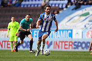 Will Grigg of Wigan Athletic makes a break. Skybet football league one match , Wigan Athletic v Southend Utd at the DW Stadium in Wigan, Lancs on Saturday 23rd April 2016.<br /> pic by Chris Stading, Andrew Orchard sports photography.